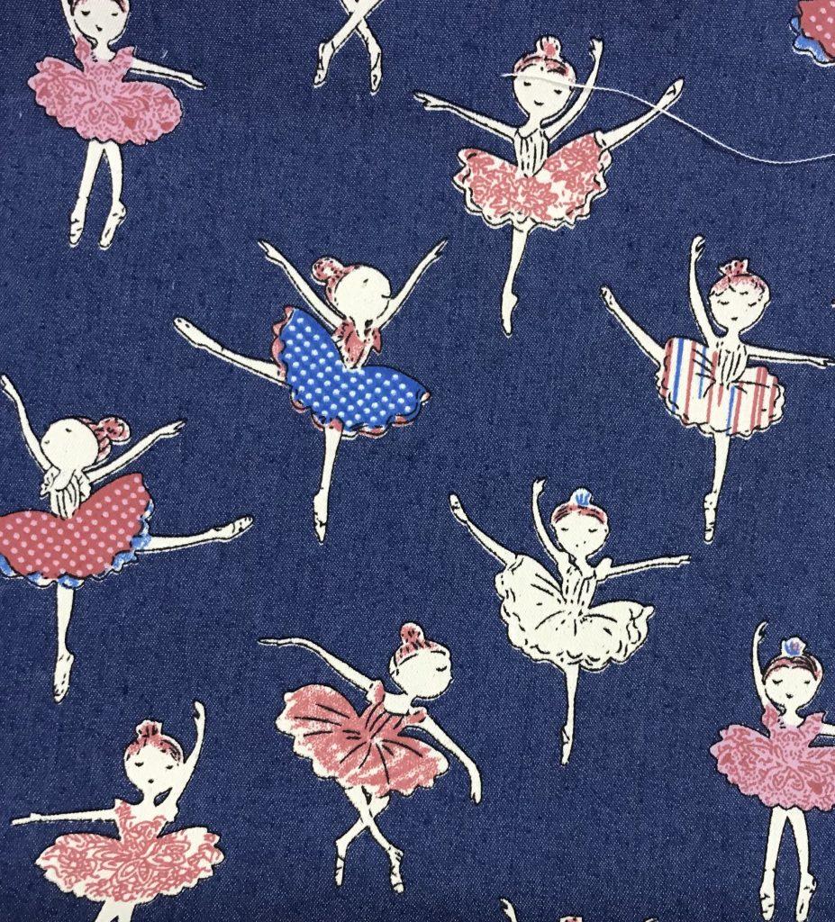 Tela azul vaquero con bailarinas.