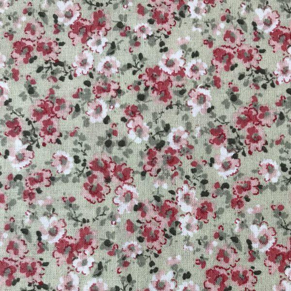 Tela popelina cruda con flor rosa.