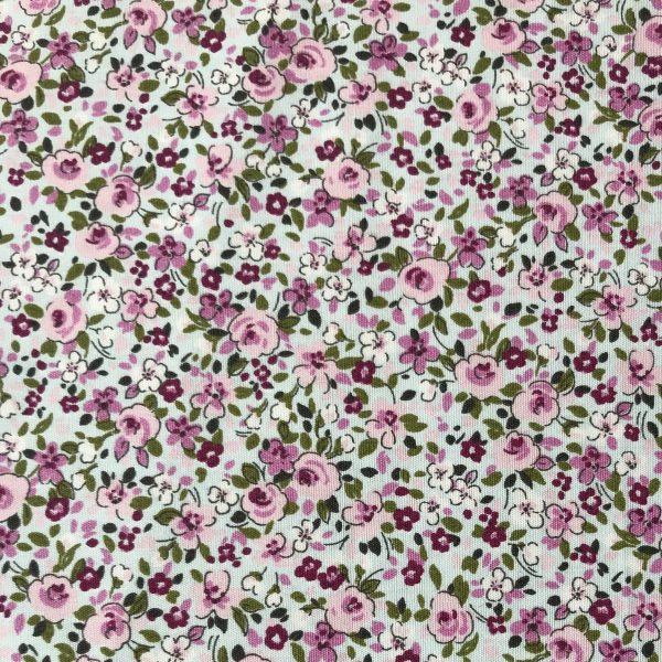 Tela popelina flor rosa pequeña.