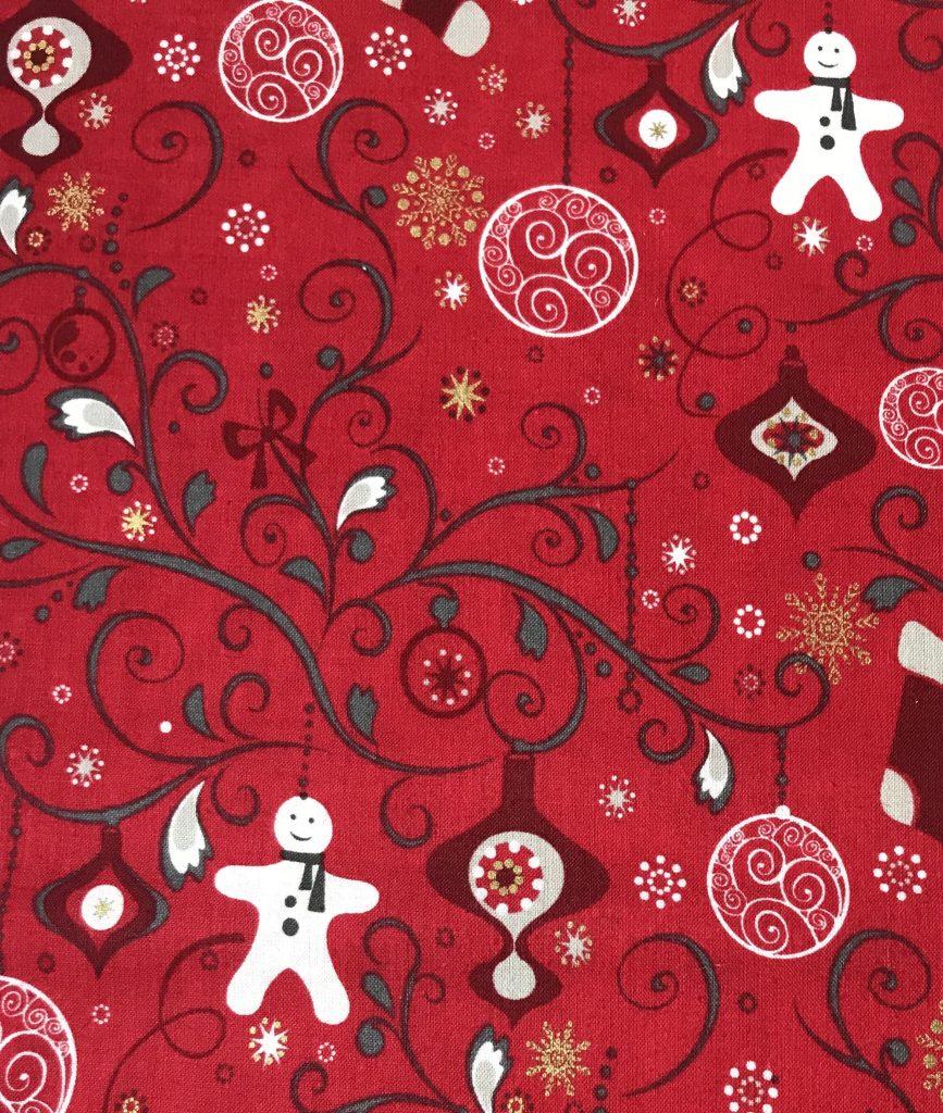 Tela roja navidad, bota y muñeco.